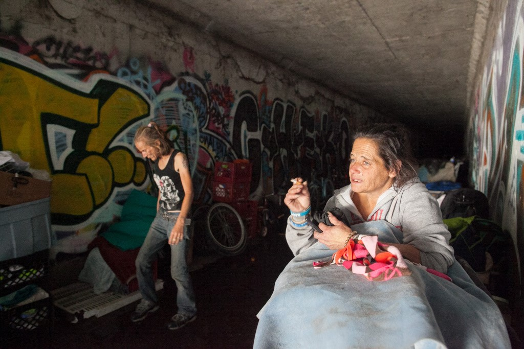 Two homeless women surrounded by graffiti