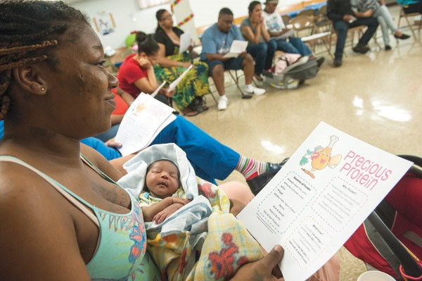 A woman and infant attending a Moms2B meeting